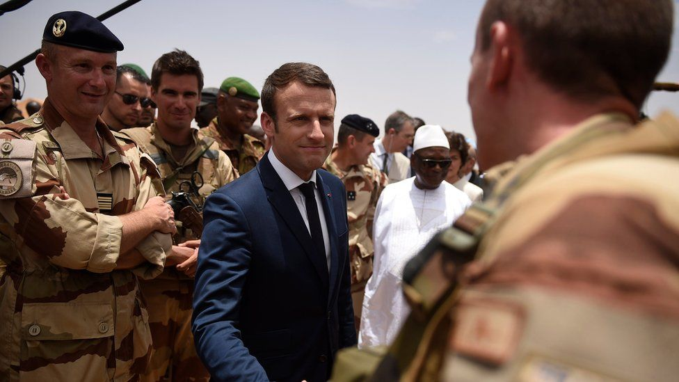 French President Emmanuel Macron shakes hands with a French soldier during a visit to Mali