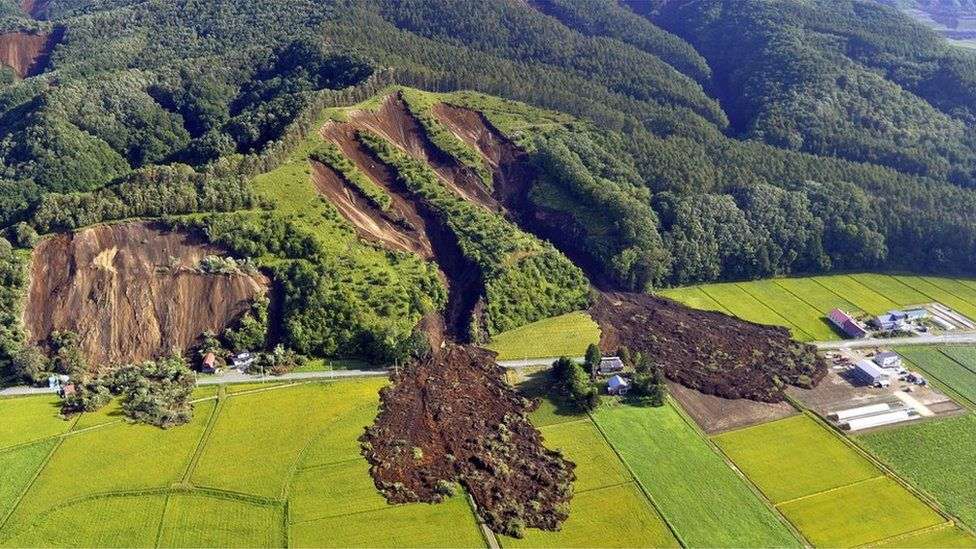 Houses destroyed by a large mudslide on a hillside