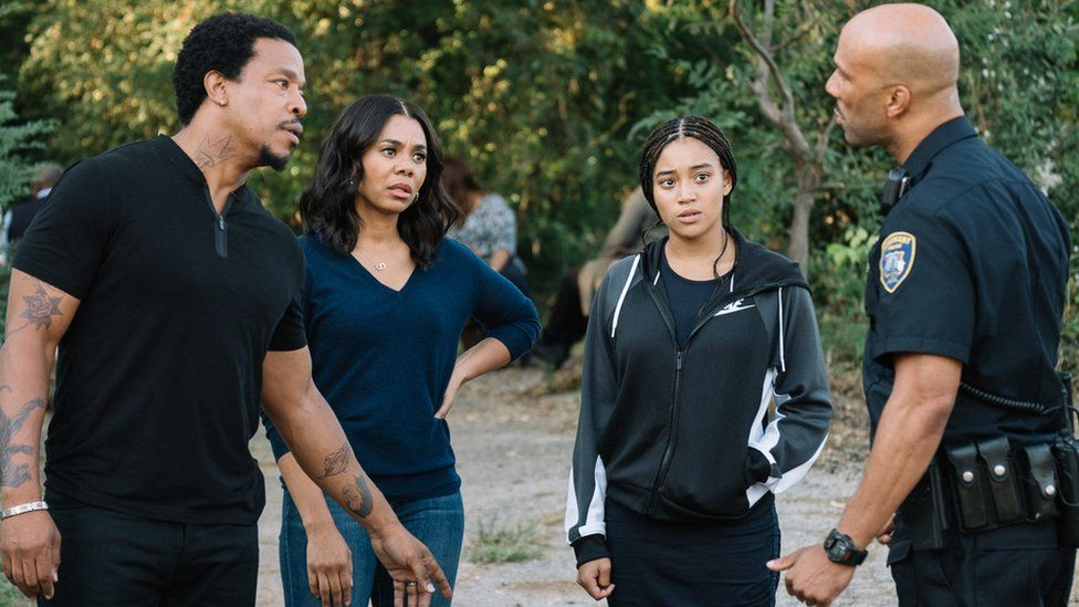 Amandla Stenberg (right) with other cast members in The Hate U Give