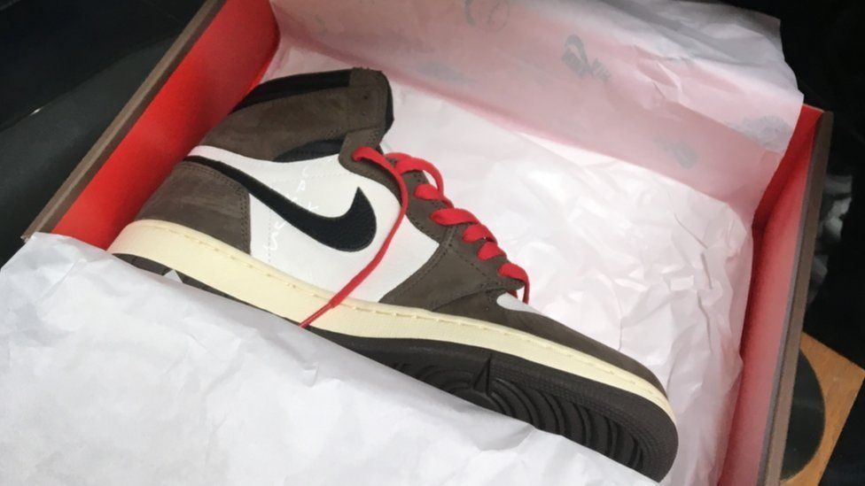 "Travis Scott Air Jordan 1 Hi OG trainers dubbed the ""trainer of the season"" were bought at retail for around £140 but being resold for £1400 pounds"