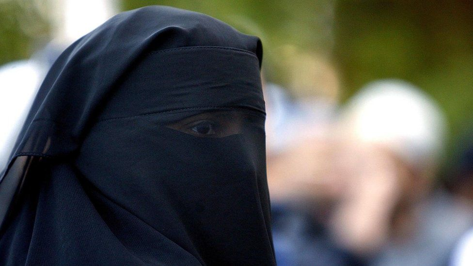 A Muslim woman with a face veil
