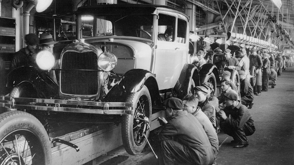 Assembly line workers inside the Ford Motor Company factory at Dearborn, Michigan, in 1928