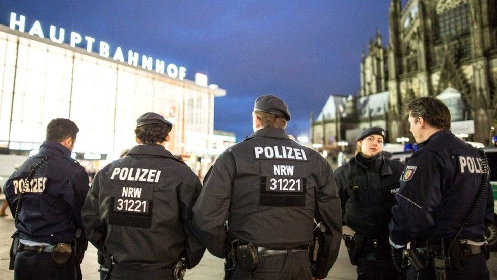 Police officers stand outside the main station in Cologne, Germany, 06 January 2016.