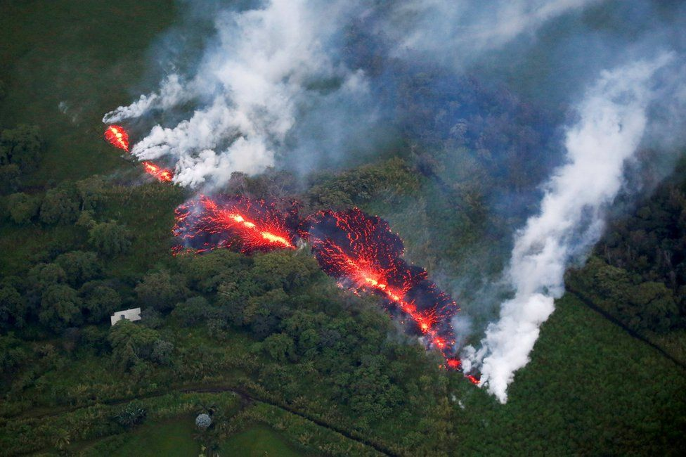 An aerial photo of a fissure with lava erupting