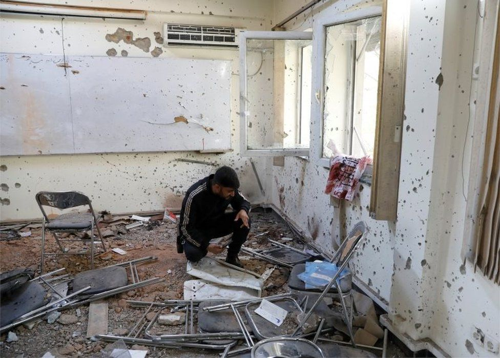 A damaged classroom after the attack at the university of Kabul