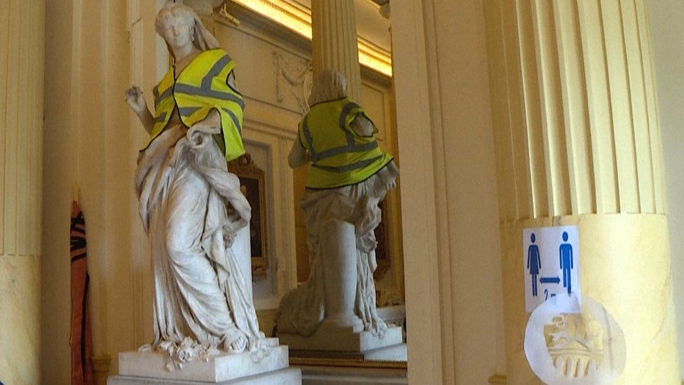 This statue in the Odeon Theatre in Paris has been draped with a yellow vest synonymous with earlier anti-Macron protests