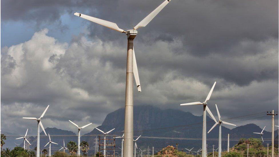 Wind turbines generate electricity in Punniyavalanpuram, Tamil Nadu, India.