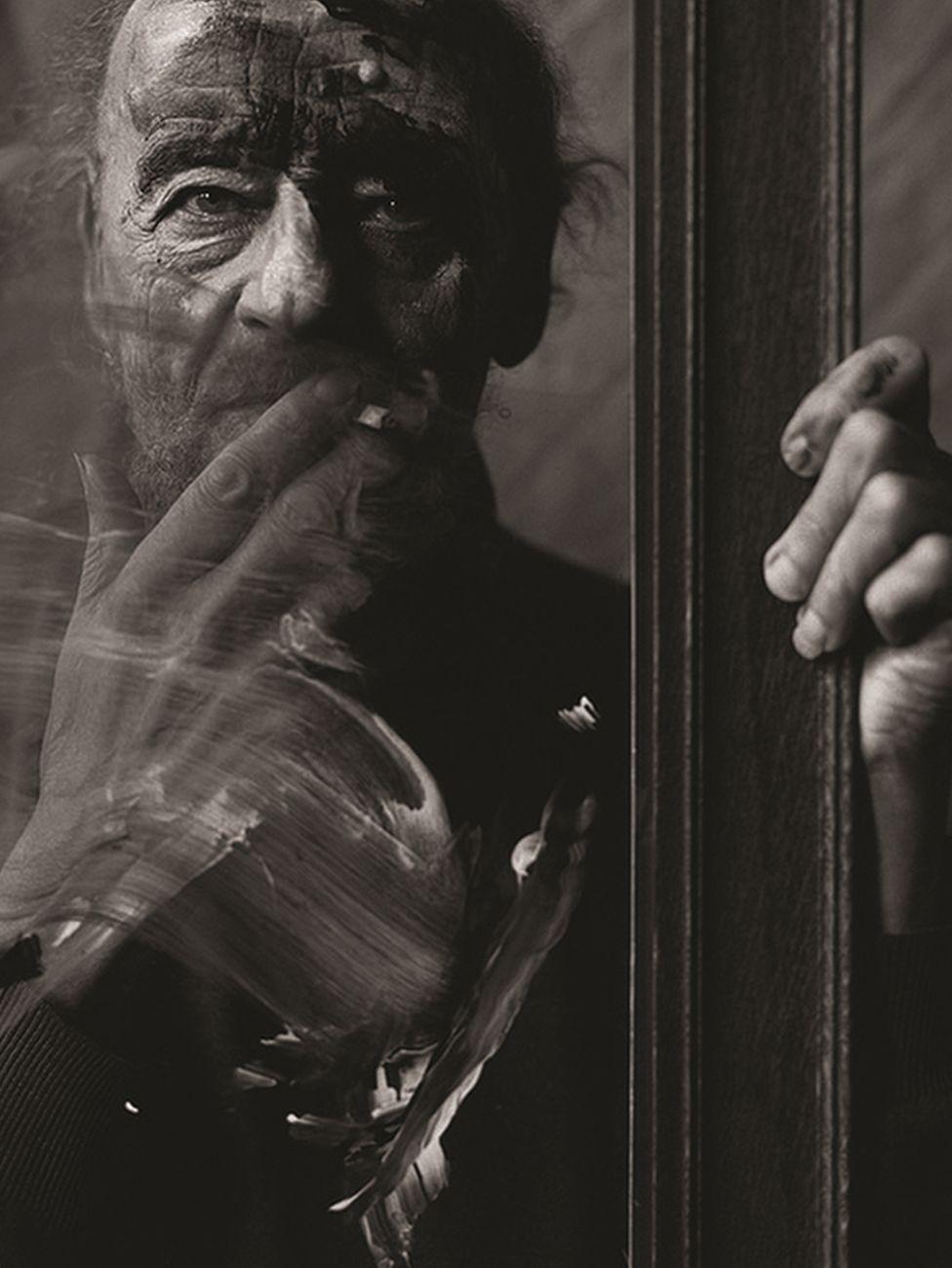 A photograph of Alan Tanner smoking