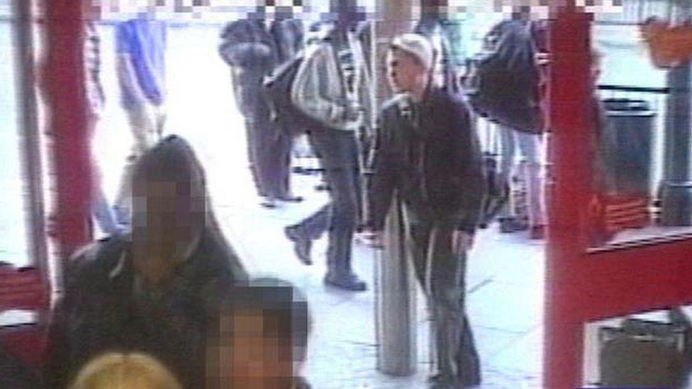 A still from CCTV footage showing David Copeland walking past the Iceland store in Brixton