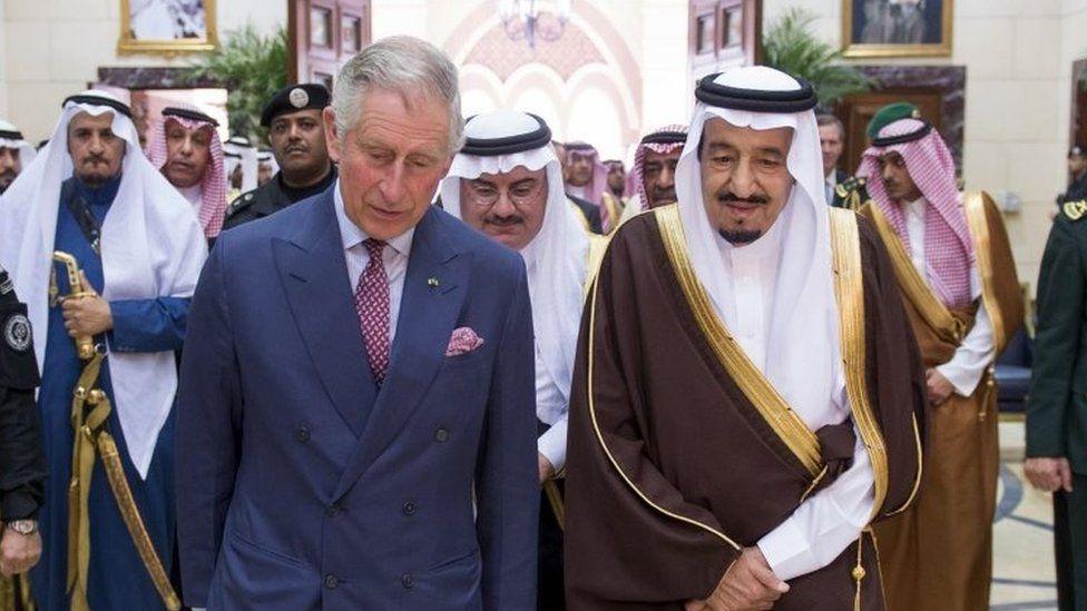 Britain's Prince Charles (centre left) walks with Saudi King Salman at the Al Ergah Palace in Riyadh (10 December 2015)