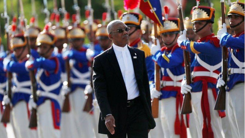 "David Granger reviews an honour guard during the Mercosur trade bloc""s annual summit in Brasilia, Brazil December, 21, 2017"