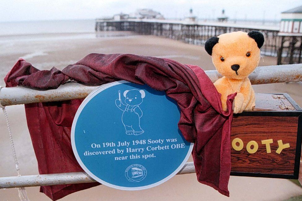 Sooty in 1997 at Blackpool North Pier with a plaque marking his purchase by Harry Corbett