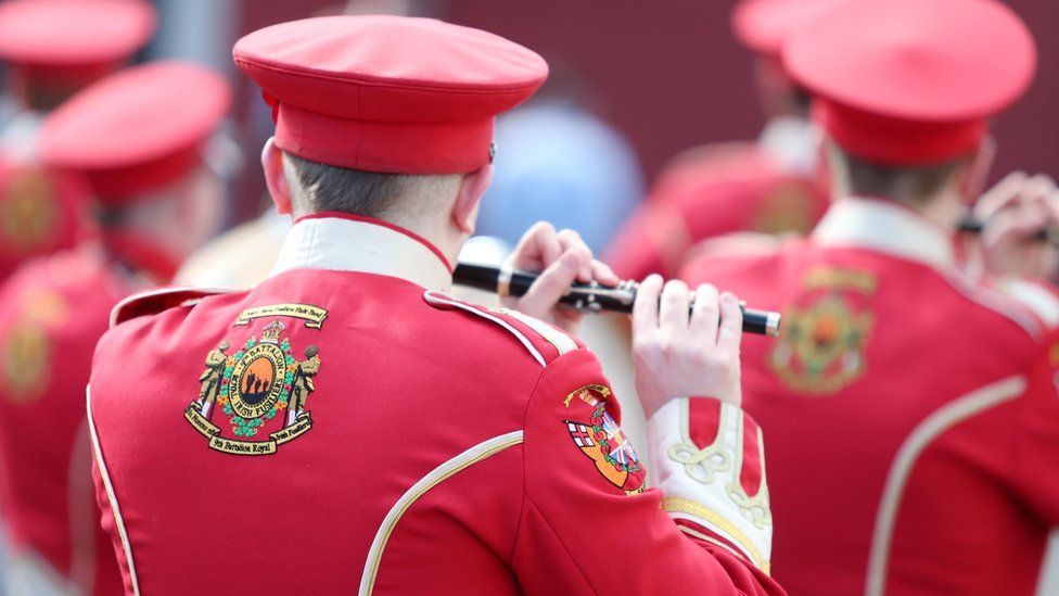 A bandsman plays a flute during a parade
