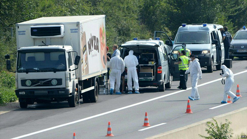 Forensic experts investigate a lorry in which several people were found dead on the A4 motorway in Austria - 27 August 2015