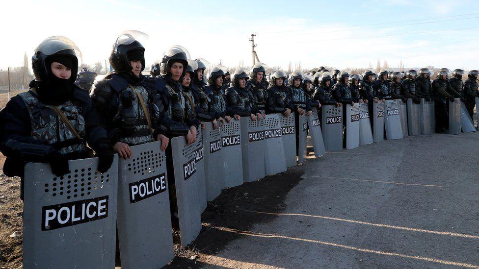 Kazakh riot police near the village of Masanchi