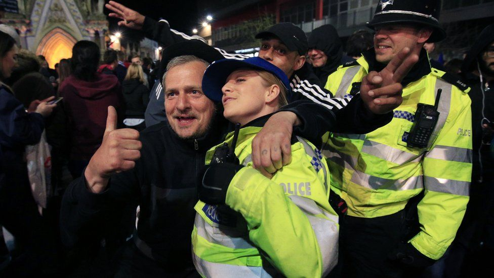 Police officers and fans