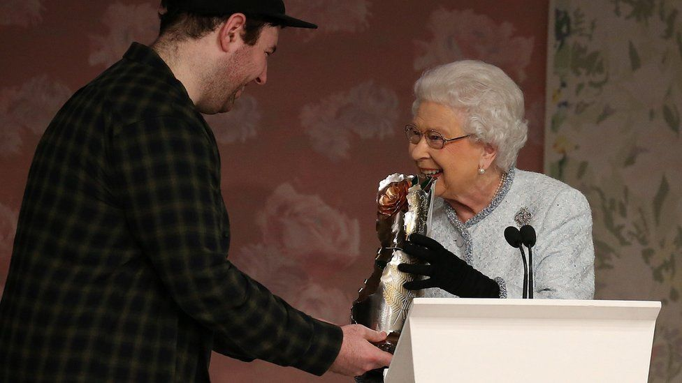 The Queen presents award to Richard Quinn