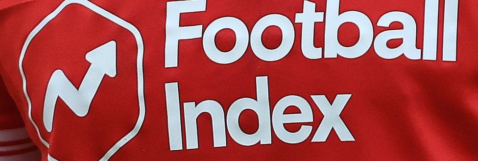 The Football Index logo and company name in white writing on the red Nottingham Forest 2020-21 home shirt
