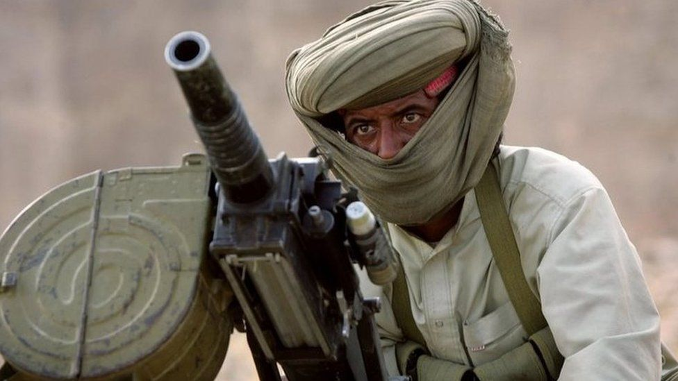 A Marri tribal guerrilla prepares to fire a grenade launcher at a Pakistani troop outpost January 31, 2006 near Kahan in the Pakistani province of Balochistan.