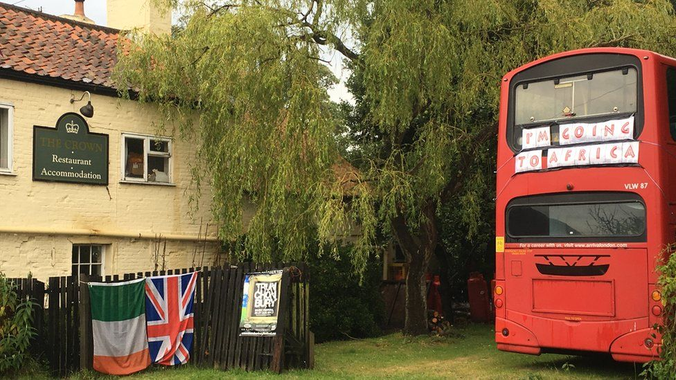 Red double decker bus at The Crown