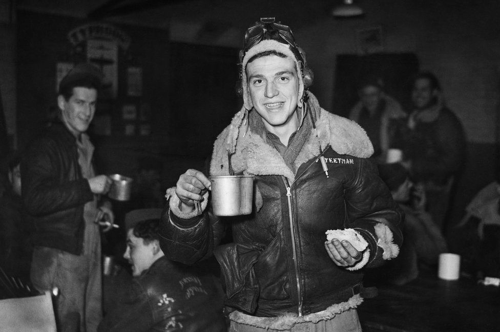 Sergeant Leo Teetman Jr celebrates New Year's Eve, 1943, with a post-mission sandwich and coffee