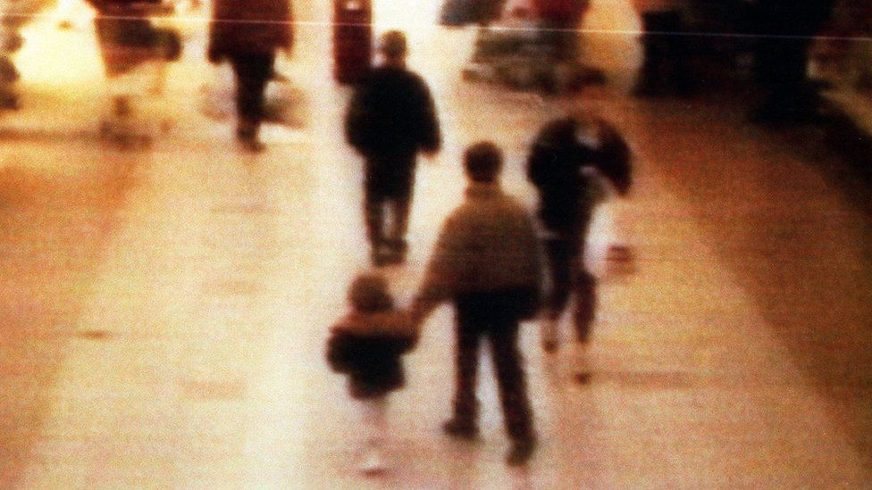 Bulger was led out of the shopping centre by Venables and Thompson