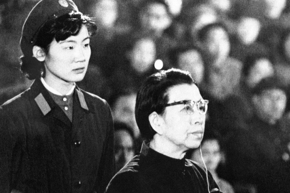 Mao Zedong's widow Jiang Qing sits in the defendant's box during her trial for crimes committed during the Cultural Revolution, on 5 December 1980