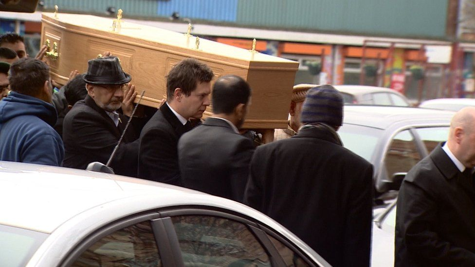 Coffin being carried into mosque