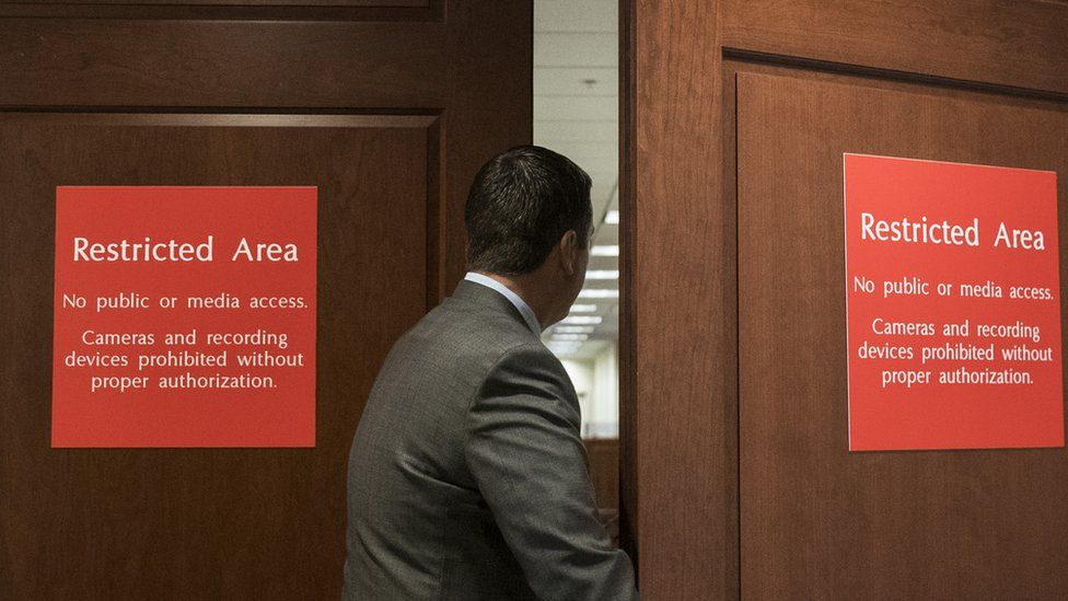 Congressman Devin Nunes enters a restricted House Intelligence Committee meeting.