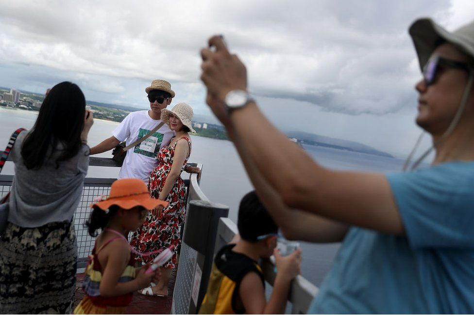 Tourists take pictures at Two Lovers Point on 16 August 2017 in Tamuning, Guam.