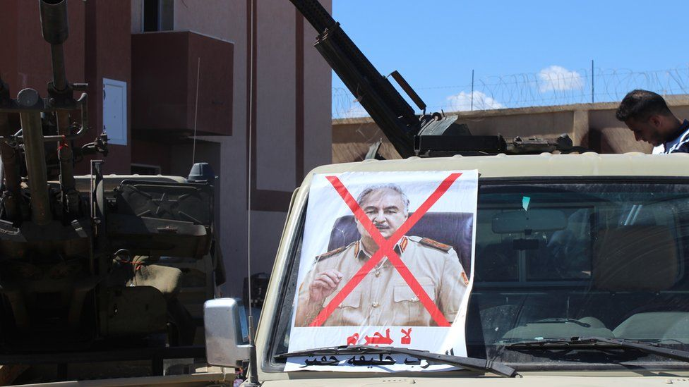 An photo of Gen Haftar with a cross through on a vehicle in Tripoli - April 2019