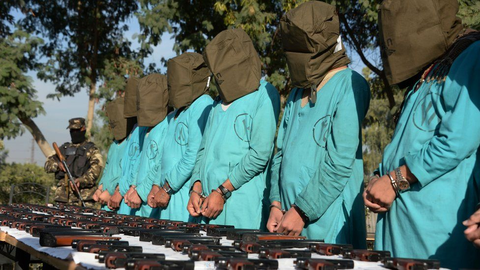 Suspected Islamic State (IS) and Taliban militants are brought before media during a press conference in Jalalabad on December 6, 2016.