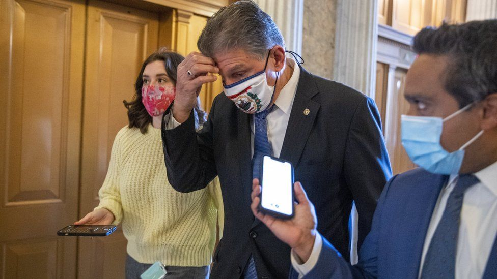 Joe Manchin responds to a question from the news media as he walks to the Senate floor to vote in the US Capitol in Washington, DC, USA, 05 March 2021