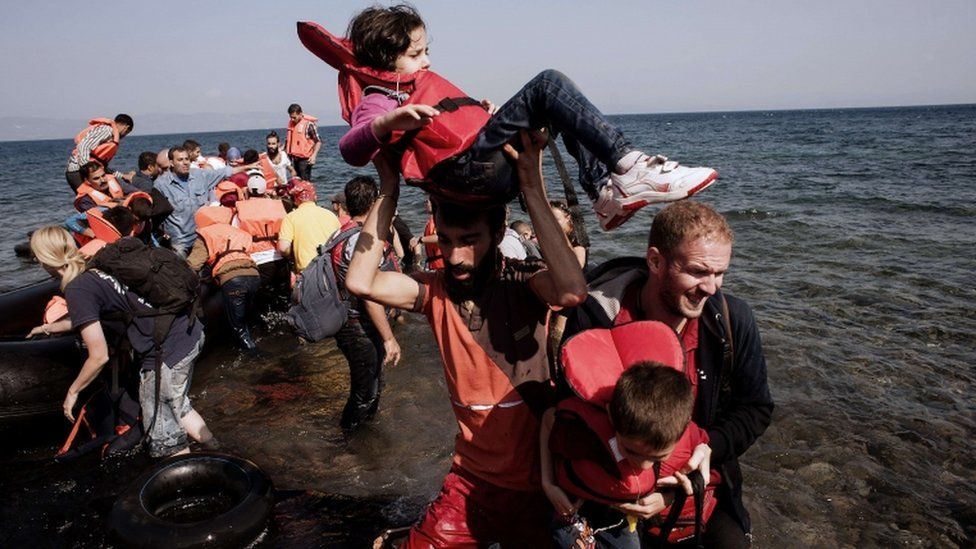 Refugees and migrants arrive on the Greek island of Lesbos