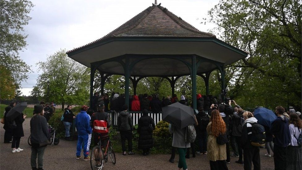 People attend a vigil in Ruskin Park for Sasha Johnson