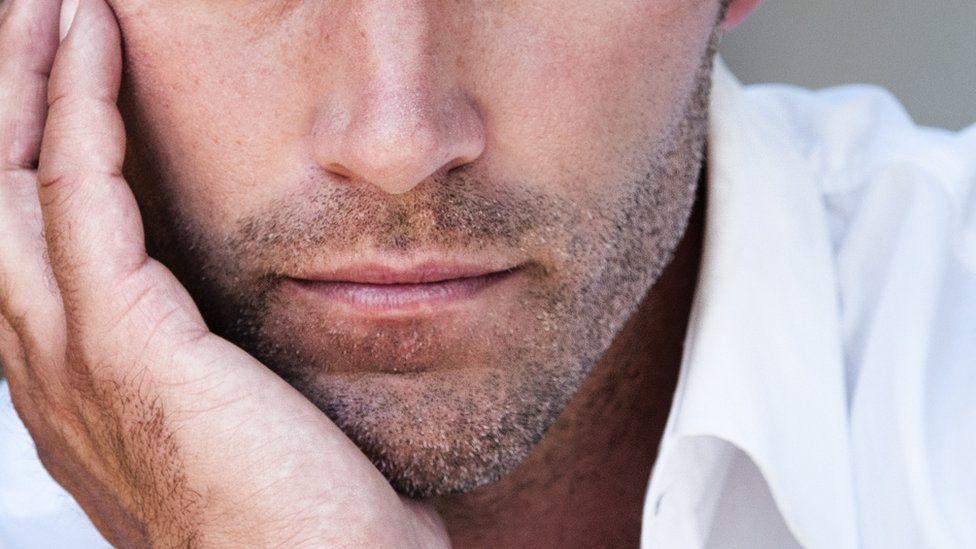 man with stubble