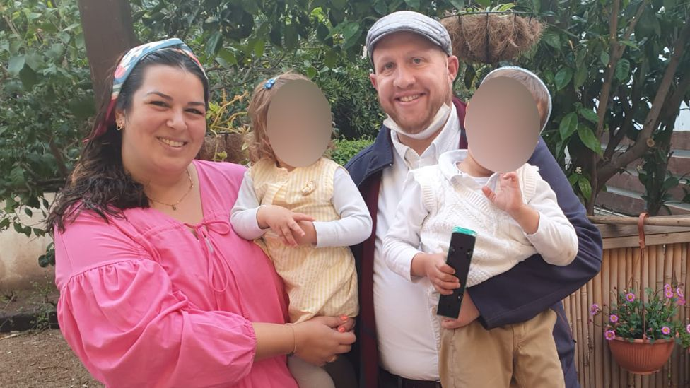 Tova Levy poses with her family.