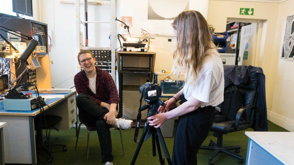 Floating points being interviewed by a student