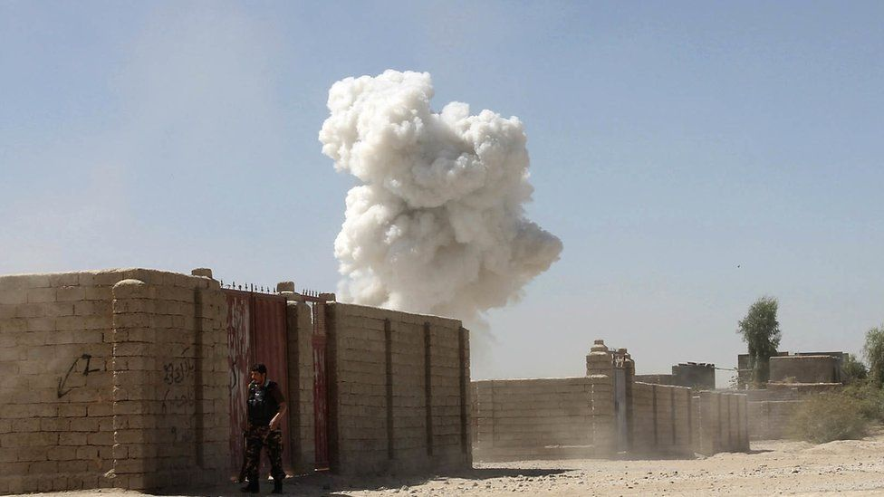 Smoke rises after a suicide attack in Lashkar Gah the capital of southern Helmand province of Afghanistan, Monday, Oct. 10, 2016