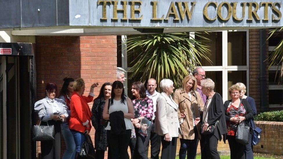 The families of Hillsborough victims await the arrival of those facing charges