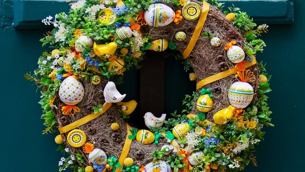 Handmade wreath with eggs, ribbons and figures of birds for easter