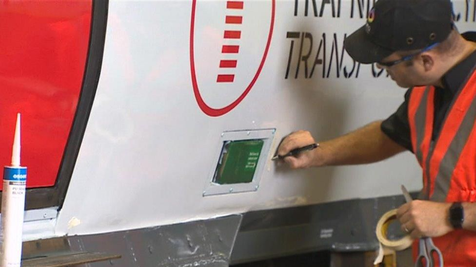 New branding on trains being applied