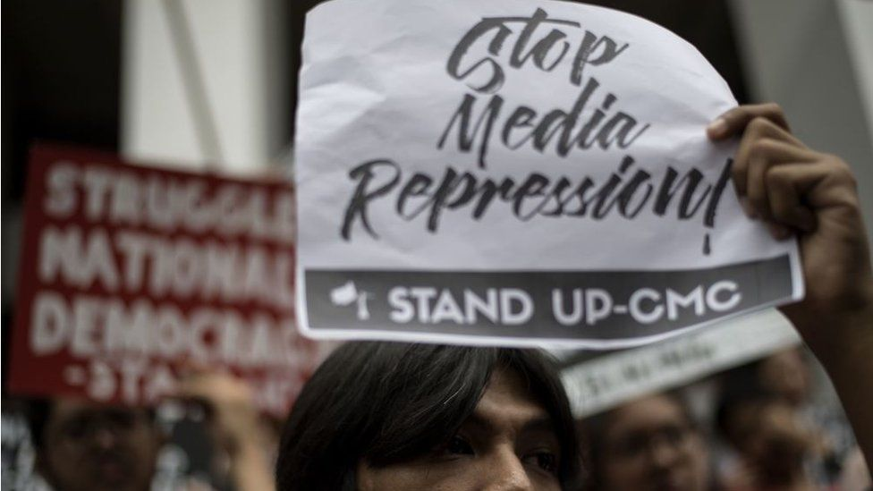 Students of the University of the Philippines participate in a protest to defend press freedom in Manila