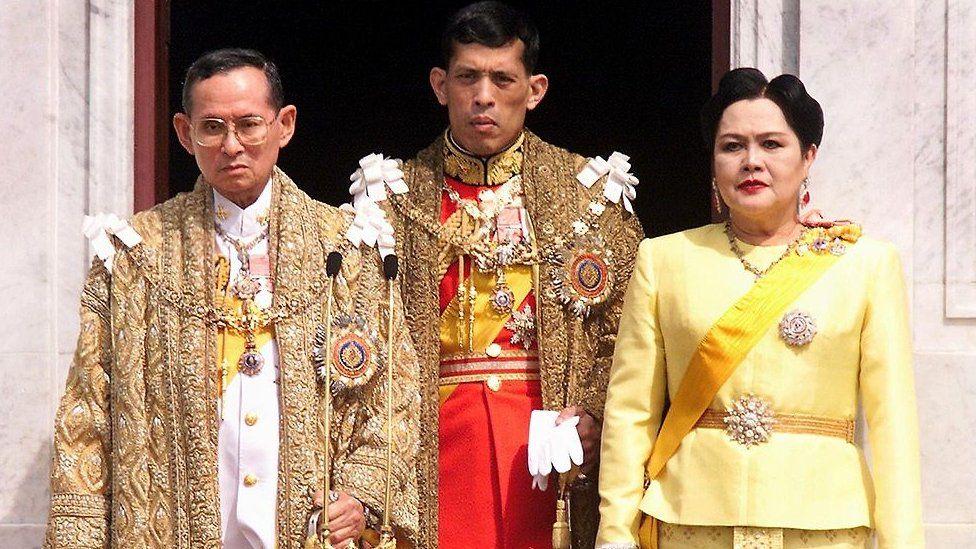 The Thai royal family, (L to R) The late Bhumibol Adulyadej, King Maha Vajiralongkorn & Queen Sirikit, 1999
