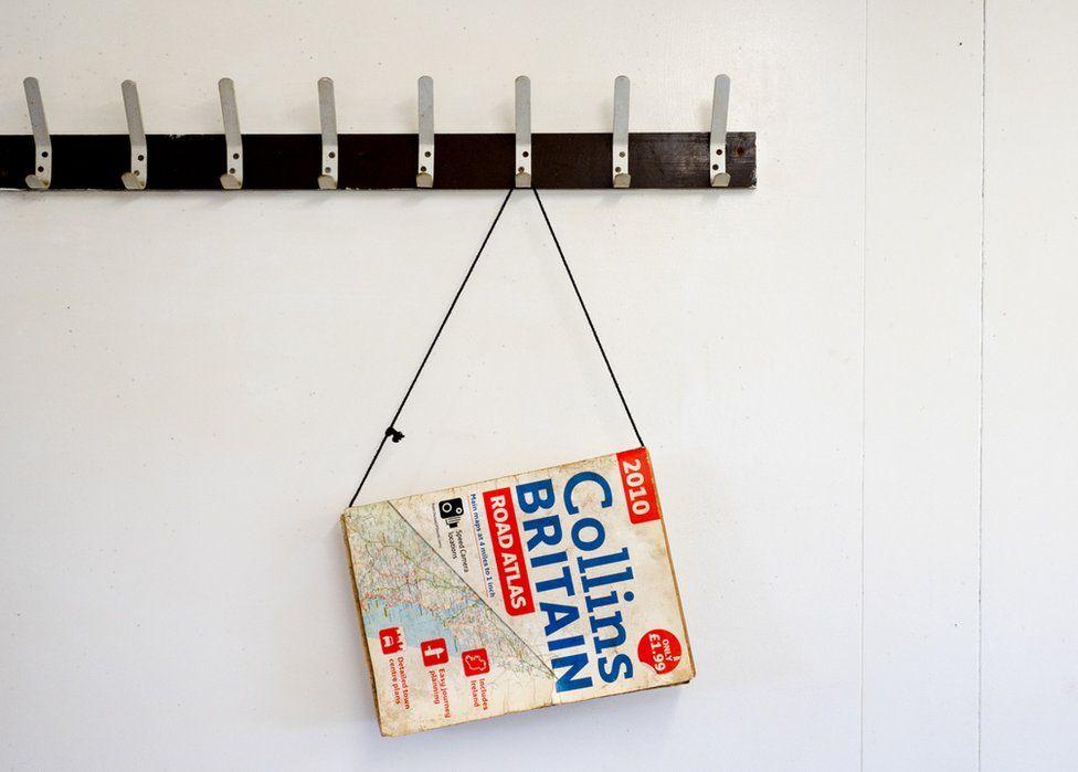 Collins Road Atlas of Britain hans inside BABS cafe. Retford, Nottinghamshire.