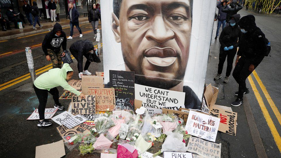 People left tributes at a mural of George Floyd in Manchester