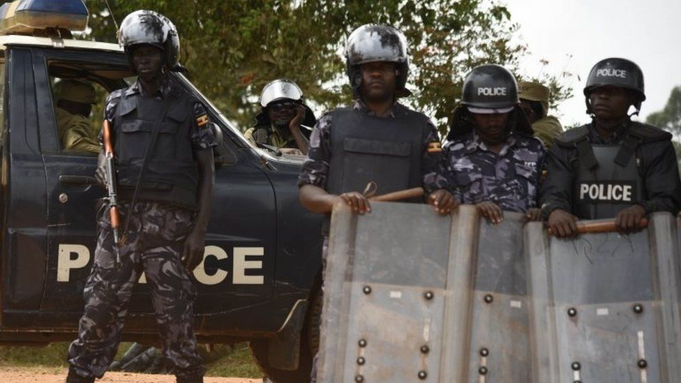 Ugandan police at the home of opposition election candidate Kizza Besigye