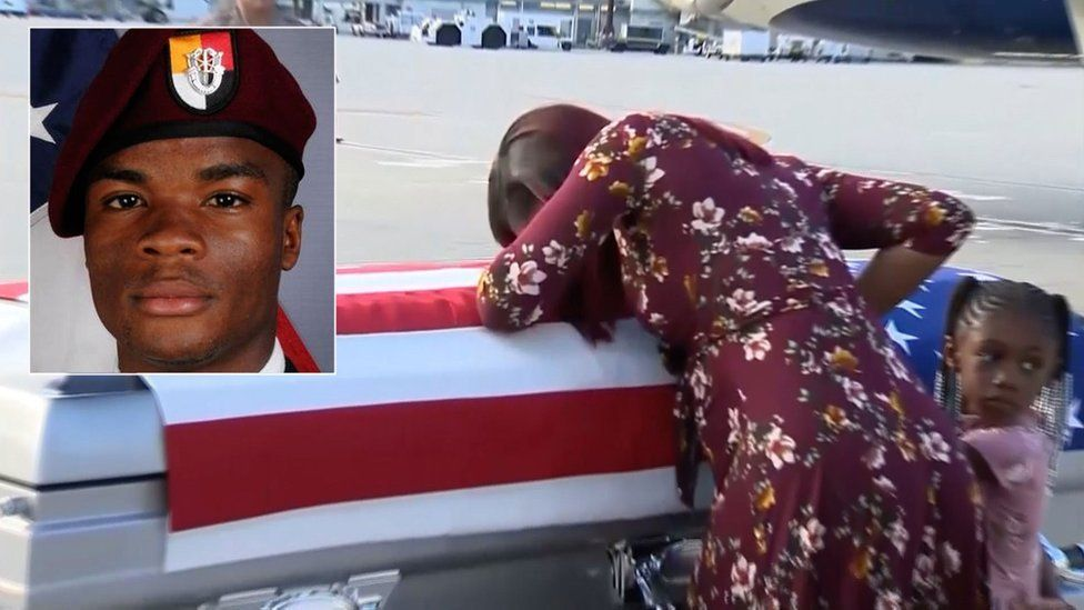 Sgt Johnson's widow with his coffin at Miami International Airport, 17 Oct 17