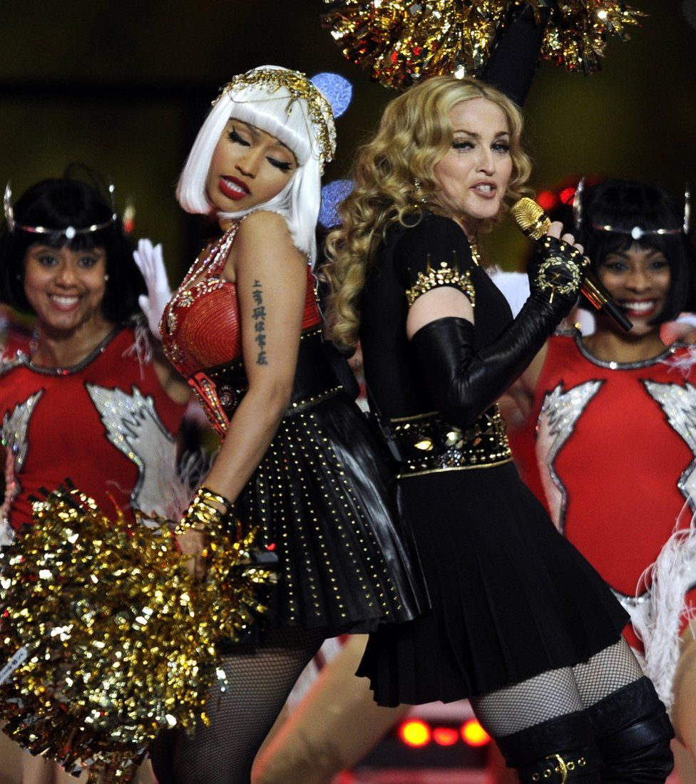 Madonna and Nicki Minaj perform during the NFL Super Bowl XLVI game halftime show on February 5, 2012 at Lucas Oil Stadium in Indianapolis, Indiana