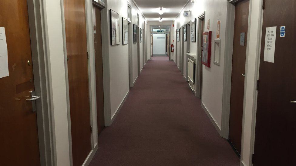 Corridor lined with clinical rooms